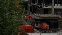 Excavator at the demolition site Stock Footage