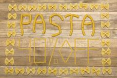 pasta  forty percent off text made of raw pasta - stock photo