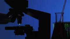 Man manipulating a microscope Stock Footage