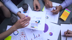 Business chart is placed on the table - stock footage