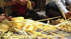 Balinese man and woman making decorations for a penjor on Galungan, close up Stock Footage