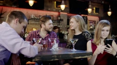 young man and woman is flirting sitting in the bar - stock footage