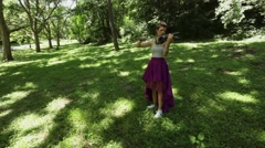 Attractive female classical musician plays electric violin outdoors; Stock Footage