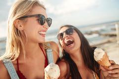 Best friends together outdoors with ice cream - stock photo