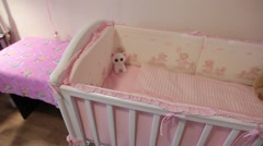 Cradle your baby in the nursery Stock Footage