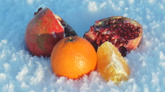 Different bright fruits are on white-blue snow. Stock Footage