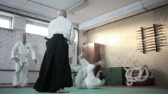 athletes in a kimono demonstrating martial arts techniques. martial arts - stock footage