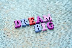 Dream big phrase on vintage wooden background Stock Photos