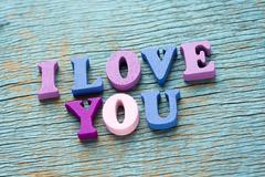 I love you phrase on vintage wooden background Stock Photos