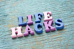 Life hacks phrase on vintage wooden background Stock Photos