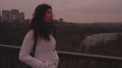 Girl walking on the bridge at the winter sunset Stock Footage