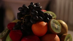 Fruit in a vase on the table Stock Footage