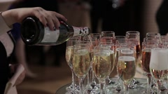 Waiter's hand holding a bottle and fills glasses wine Stock Footage