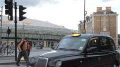Taxis and commuters at Kings Cross Station London. Stock Footage