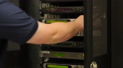 Tech works in the telecommunications server room - stock footage