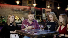 Male Customer paying with a credit card in a pub Stock Footage