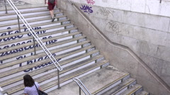 Commuters walking up stairs Stock Footage
