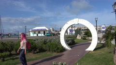 Girl passes through the Moongate at Royal Naval Dockyard. - stock footage