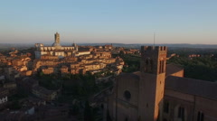 Flight over a medieval Town of Siena - stock footage