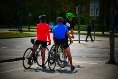 Europe Germany German group cyclist stop by traffic light - stock photo