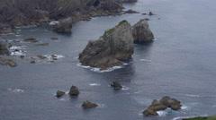 Rugged coastline near San Juan de Gaztelugatxe Stock Footage