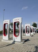 Europe Germany Tesla electric auto Recharging station - stock photo
