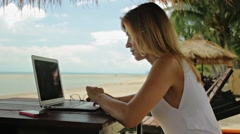 Woman freelancer working at the beach Stock Footage