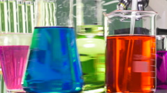 Three bottles of various shapes and colors on a turntable Stock Footage