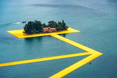 The floating piers. The artist Christo walkway on Lake Iseo St.Paul island. Stock Photos