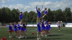 Group Acrobatic Performance Of The Cheerleading Team - stock footage
