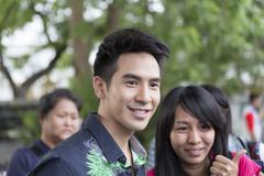 Thanawat Wattanaputi or Pope, famous Thai actor, taking photo with his fan cl - stock photo