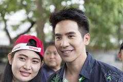 Thanawat Wattanaputi or Pope, famous Thai actor, taking photo with his fan cl Stock Photos