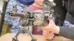 A man touches a machine gun - stock footage