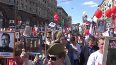 Immortal regiment march in the Victory Day on 9th of May. Marches to commemorate - stock footage