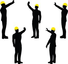 Worker silhouette with yellow protective headgear Stock Illustration