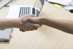 businessman handshaking for use as cooperation, acquisition concept - stock photo