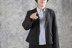 Finger of businesswoman pointing to you for use as hand pushing touch screen, Stock Photos