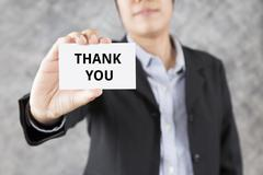 businessman presenting business card with word thank you - stock photo