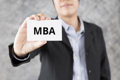 businessman presenting business card with word MBA - stock photo