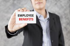 Businessman presenting business card with word employee benefits Stock Photos