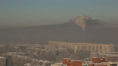 Giant factory chimney emits smoke over the winter city, pollutes air and Stock Footage