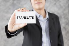 Businessman presenting business card with word translate Stock Photos