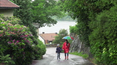Family walk on a rainy day Stock Footage