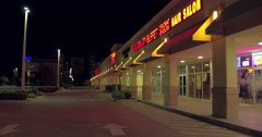 Shopping plaza at night Stock Footage