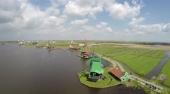 Aerial moving past most windmills in background showing rest of Zaanse Schans 4k Stock Footage