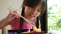 4K : Asian girl eating Japanese food sushi in a restaurant - stock footage