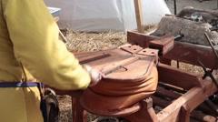 Blacksmith blows the bellows Stock Footage