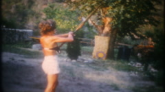 3376 practice in the backyard with the bow & arrow-vintage film home movie - stock footage