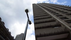 Time lapse of sky and Barbican tower, residential block in London Stock Footage