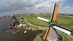 Aerial Zaanse Schans moving past windmills then turning towards mills blades 4k Stock Footage